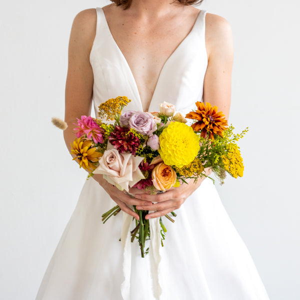cheer-bridesmaids-bouquet-for-wedding-or-elopment-with-yellow-and-orange-flowers