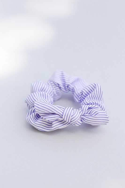 Striped blue scrunchie hair accessory with bow detail.