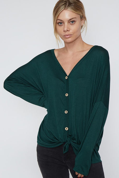 Women's long sleeve, oversized, button down casual top in hunter green with tie front detail.