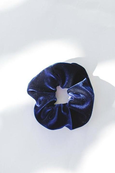 Hair accessory scrunchie in velvet navy color.