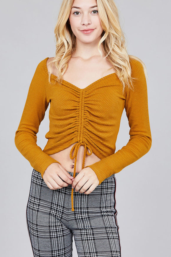 Women's long sleeve, rib knit, camel, crop top with ruching detail.