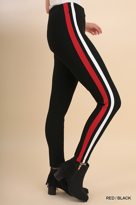Women's black legging with red and white stripe detail down the outer side of leg.