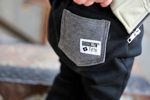 Whoever said you can't be stylish AND comfortable has never tried a pair of our City Comfort Toddler Joggers by Brooklyn + Fifth! We combined a comfortable sweatshirt fabric with cozy fleece lining and added stylish design features including a mock fly, a contrasting color back logo pocket and elastic cuffs to show off your sneakers! The result is the ultimate blend of style + comfort!  These pants have taken over the fashion industry and now you can own a pair for your stylish toddler as well!