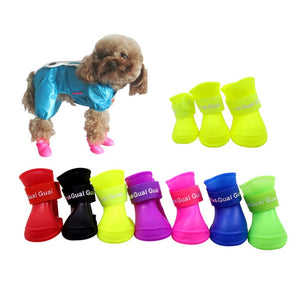 The pet dog boots with four silicone antiskid shoes wear waterproof dogs shoes candy colored pet rainy days appear essential