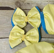 Add a beautiful matching hair or Dress Bow