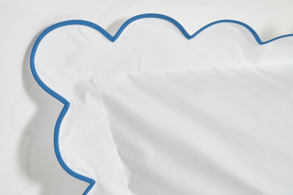 White with 45 blue scalloped bed linens