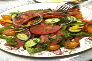 Plate of cut up vegetables, tomatoes, onions, cucumbers, peppers - Salad - ILYNSI Yoga