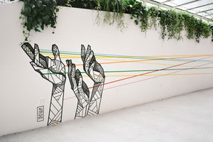 Karma Series: The Law of Connection - ILYNSI Yoga - Street art - hands holding strings