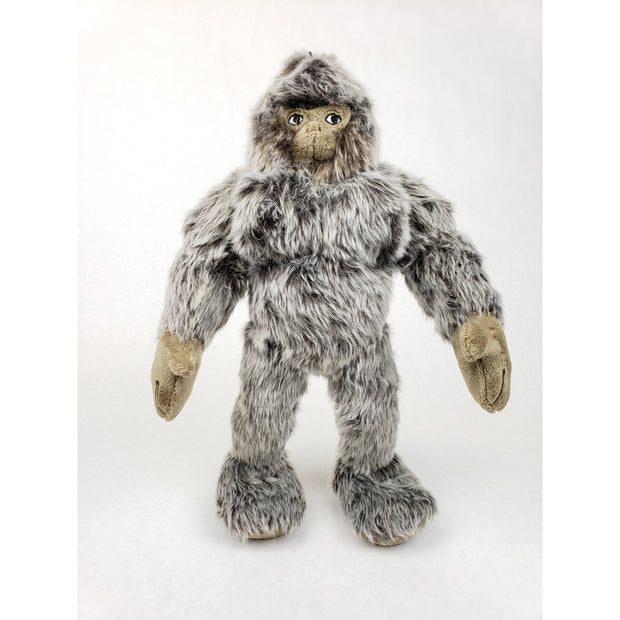 front of gray, furry Bigfoot Toy