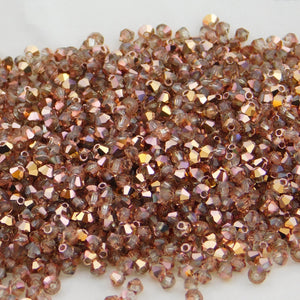 3mm Preciosa Crystal Bicone_Crystal Capri Gold_50 Beads