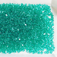 4mm Swarovski Bicones_ Light Emerald Green_ 50 beads