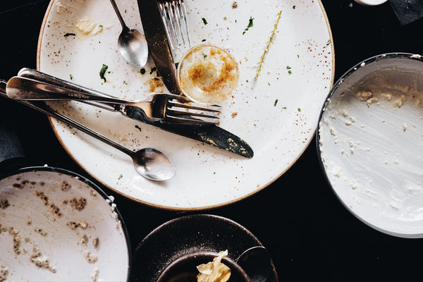 Empty Plates with Scraps of CBD Infused Food - Looks Like Someone Enjoyed their meal