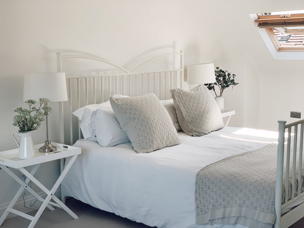 A Bright, Serene Picture of Beautifully Made bed With White and Cream Covers