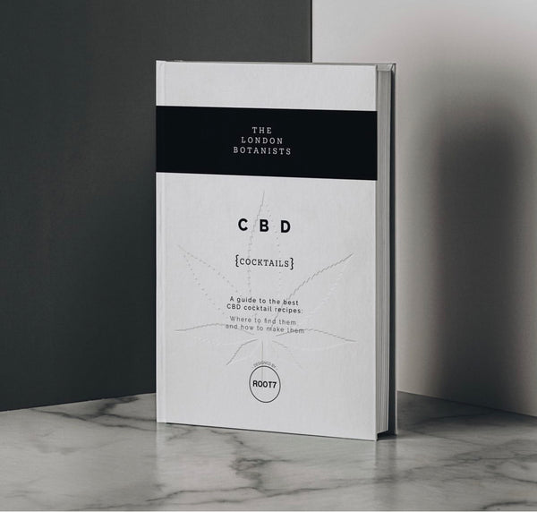 a classy looking CBD Cocktail book on a marble surface