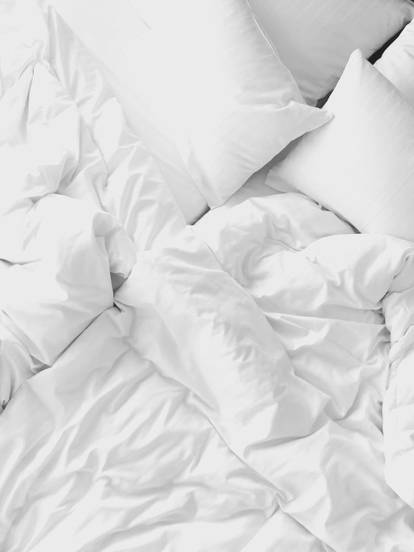 Clean White Fluffy Bed Sheets