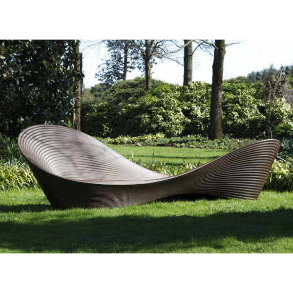 magis folly bench - ron arad in garden | ikonitaly