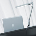 luceplan bap led iconic table lamp -  white lamp with apple laptop | shop online ikonitaly