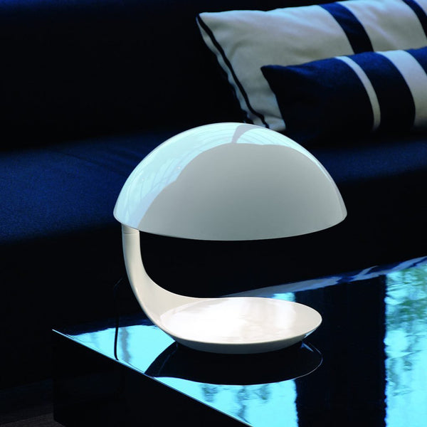 martinelli cobra iconic table lamp - white on side table | shop online ikonitaly