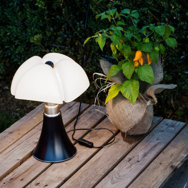 martinelli minipipistrello iconic table lamp - dark brown on side table | ikonitaly