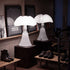 martinelli pipistrello iconic table lamp - white in front of mirror | ikonitaly