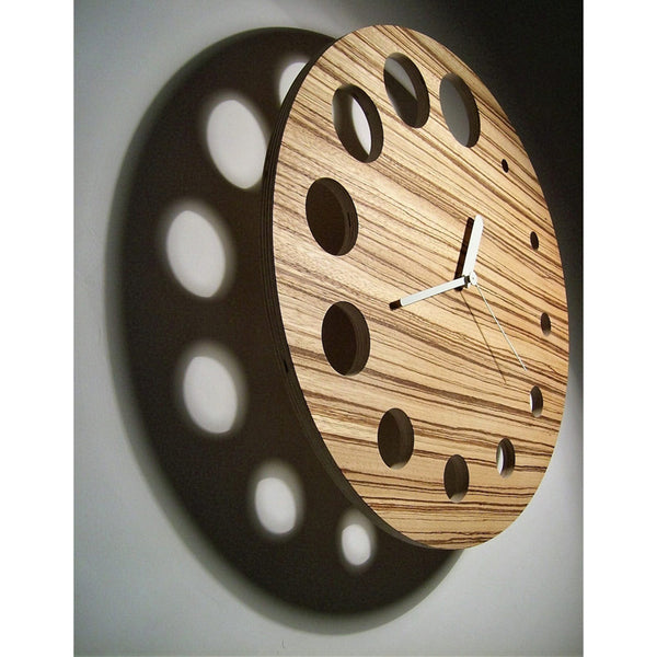 minimaproject flying saucer wall clock, wood, circular holes instead of numbers | ikonitaly