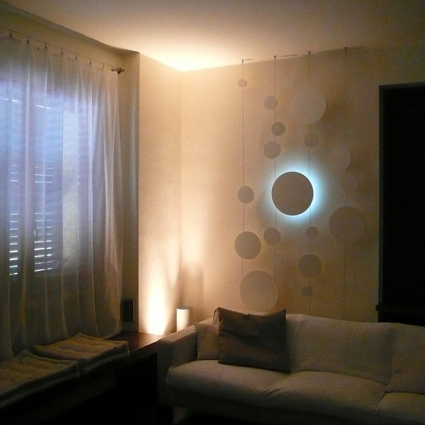 minimaproject dots 3d suspended art - white illuminated against wall | ikonitaly