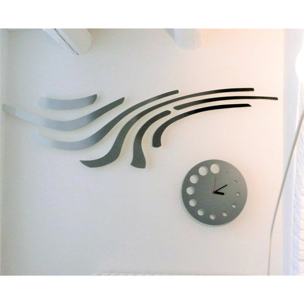 minimaproject eames 3d wall art sculpture, black, in showroom with clock | ikonitaly
