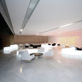 slide snake luminous bench white in conference room | ikonitaly