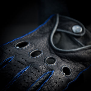Blue leather driving gloves