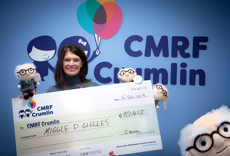 CMRF representative holding a cheque for over €10,000 from Miggle D Giggles