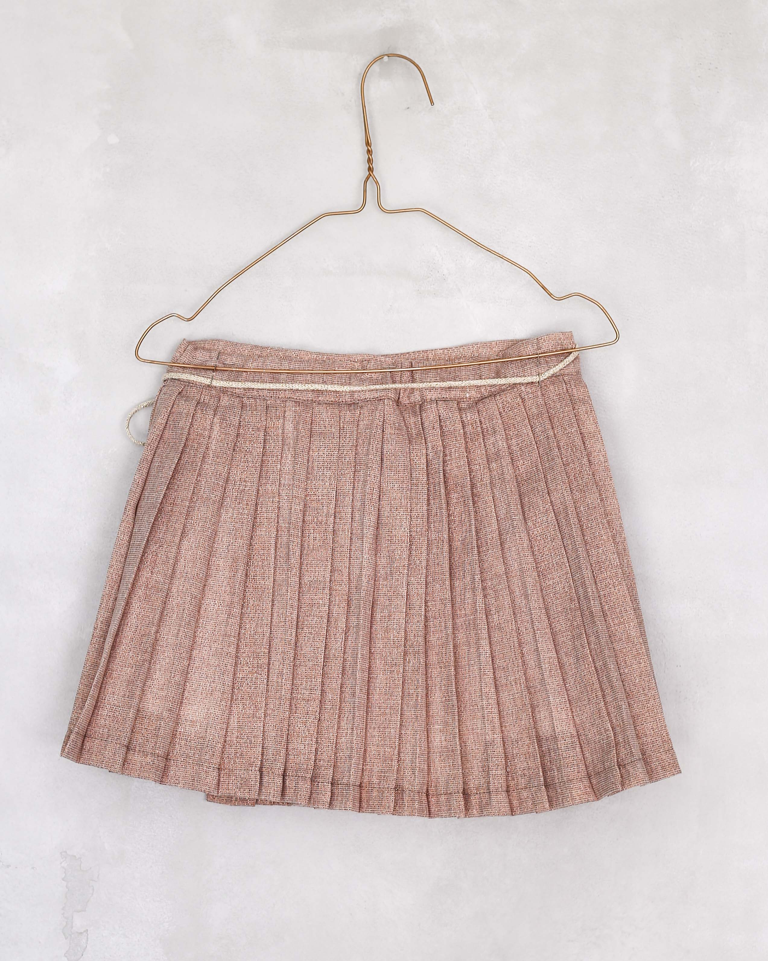 Pleated wrap skirt in Rose gold recycled lurex. Crossed on one side and tied by two lurex cords. Perfect  for special ocassion, wedding guest, flower girl, or just casual look with a tshirt.