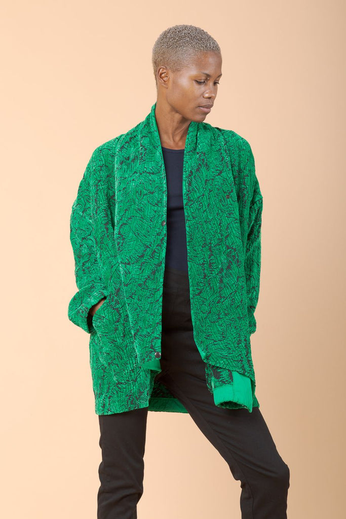 This beautiful kelly green brocade coat is sure to have you noticed.