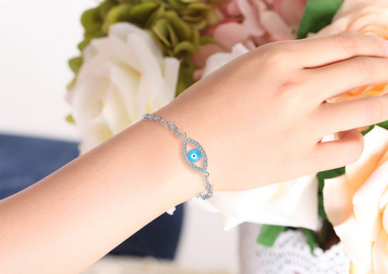 Sterling Silver Bracelet with Cubic Zirconia and Blue Evil Eye Stone Charm