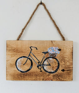 Bicycle Carrying Flowers Sign