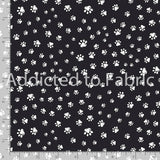 Paw Prints on Black Fabric by the Yard and Half Yard, Timeless Treasures