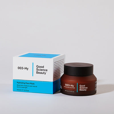 Frosted amber glass jar and cardboard product box of 003-Hy Hydrating Face Mask against light grey background.
