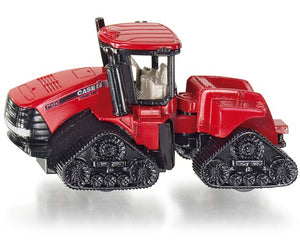 A Mini Case IH Quadrac Trac...