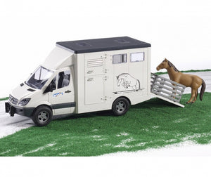 This horse lorry comes with...