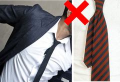 loose tie tail or tucked in shirt