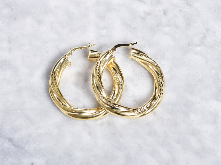 Fancy Twisted Design Hoop Earrings