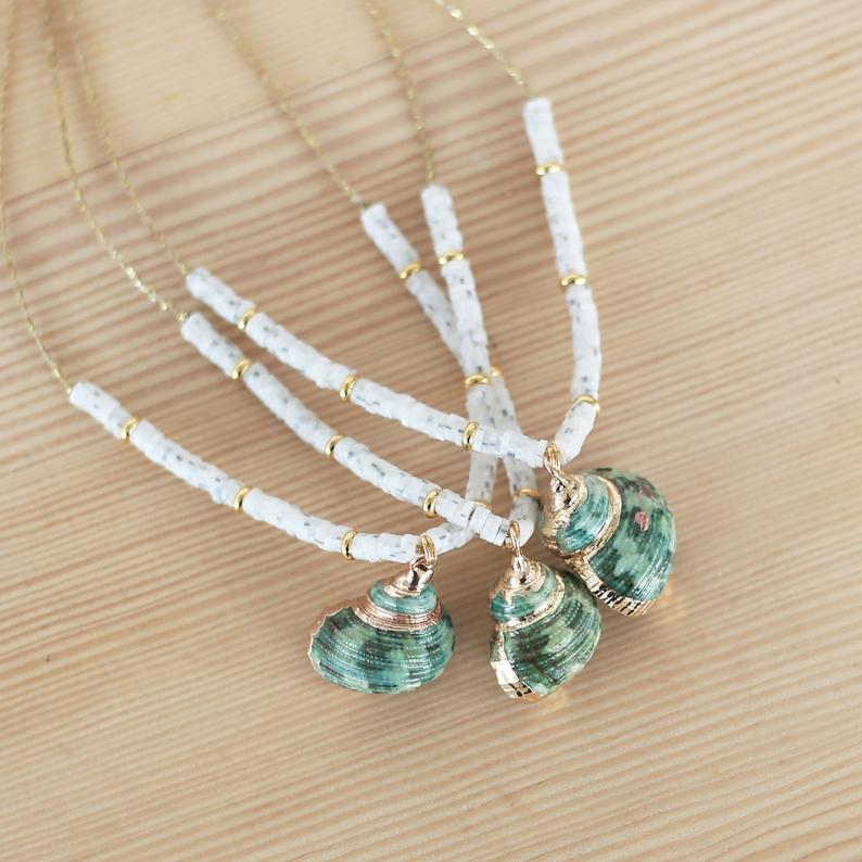 Green shell necklace, white clay beads,