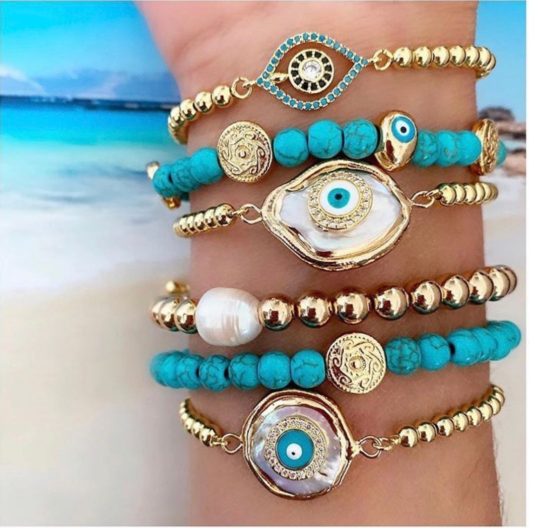 Gold bracelet with turquoise evil eye charm