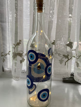 Load image into Gallery viewer, Evil eye Wine bottles