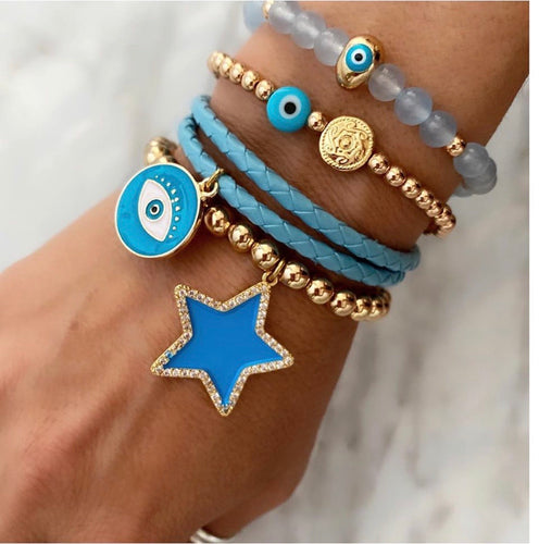 Gold bracelet with blue star charm