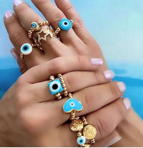 Trendy round evil eye ring