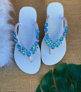 White flip flops with turquoise stones