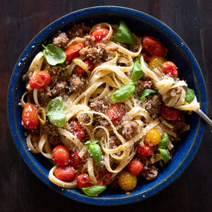Sausage And Cherry Tomatoes Over Pasta