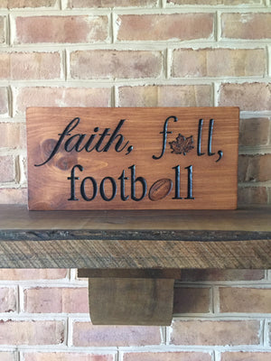 Faith, fall, football sign