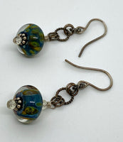 Earrings of lamp work glass and lemon quartz with sterling silver
