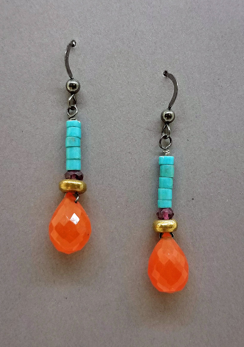Earrings of semi-precious stones with a faceted drop